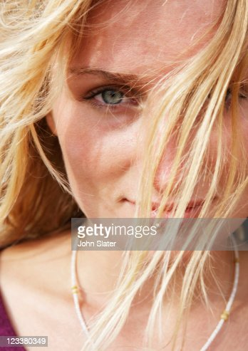Portrait of wind-swept young woman : Stock Photo