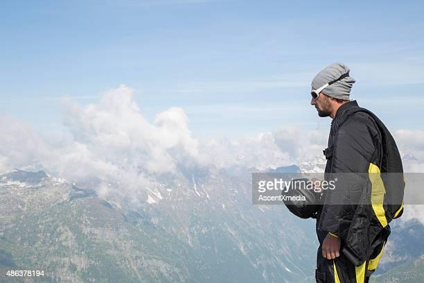 Portrait of wingsuit jumper about to launch