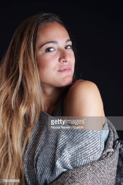 Portrait Of Woman Against Black Background