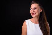 Studio Portrait Of Happy Woman Against Black Background