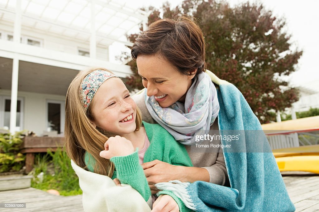 Portrait of woman and girl (8-9) relaxing : Stock Photo