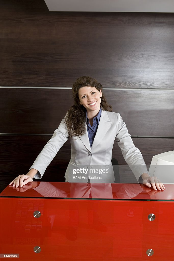 Portrait of woman at a desk : Stock Photo