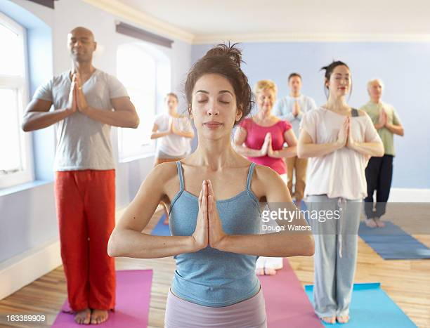 Portrait of woman at front of meditation group.
