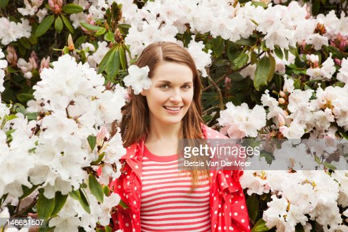 portrait of woman between white rhododendrons. : Stock Photo