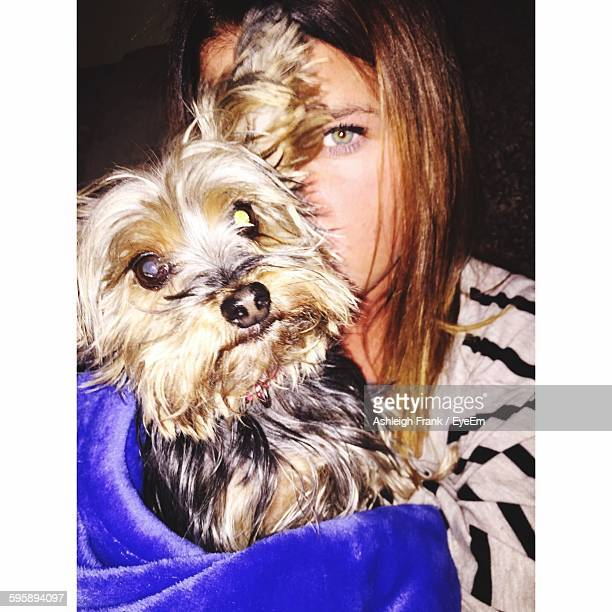 Portrait Of Woman Carrying Yorkshire Terrier