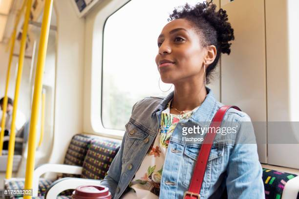 Portrait of woman commuting on a train