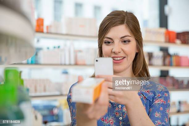 Portrait of woman comparing products in a pharmacy