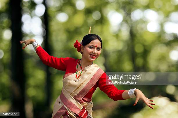 Portrait of woman doing Bihu dance