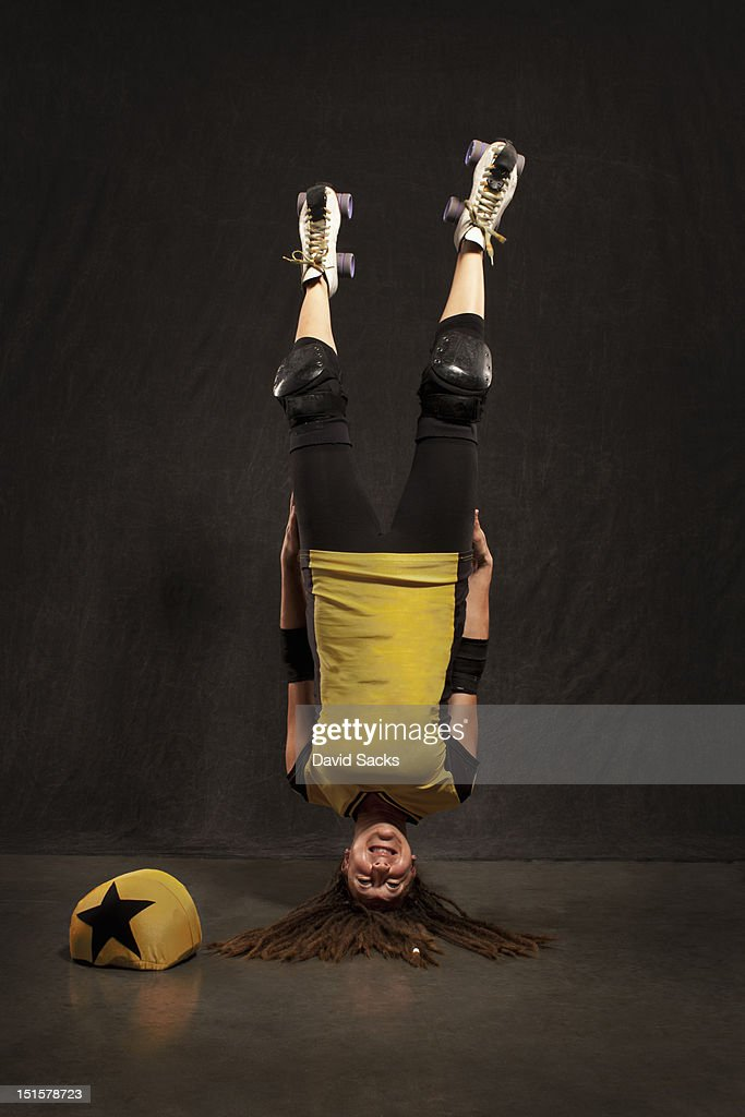Portrait of woman doing headstand : Stock Photo