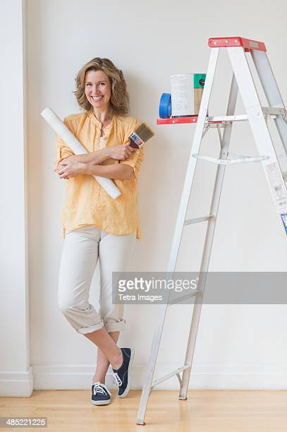 Portrait of woman doing home improvement