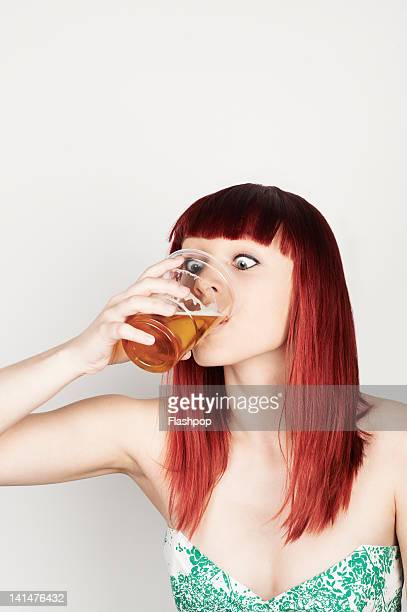 Portrait of woman drinking a pint of lager