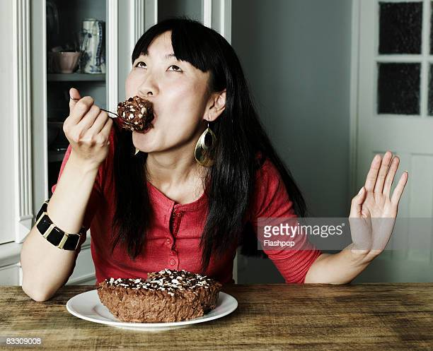 Portrait of woman eating chocolate cake