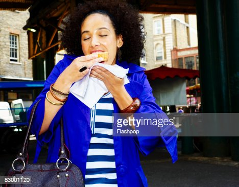 Portrait of woman enjoying fresh food : Stock Photo