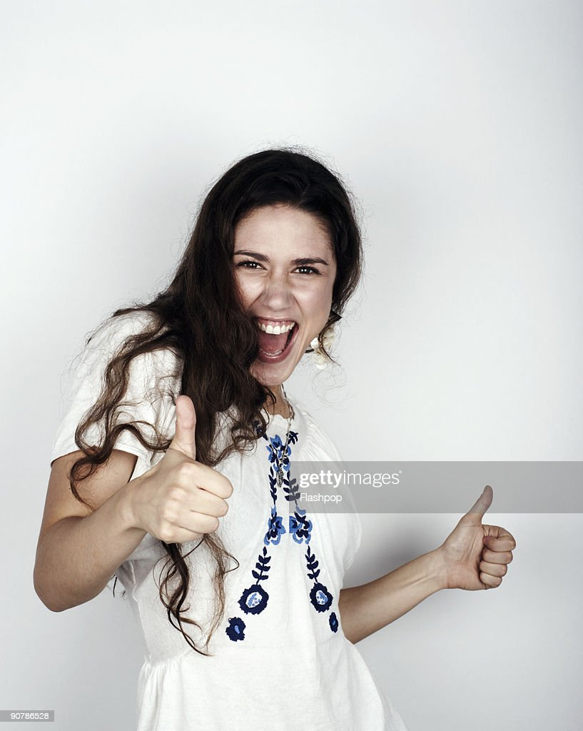 Portrait of woman giving the thumbs up : Stock Photo