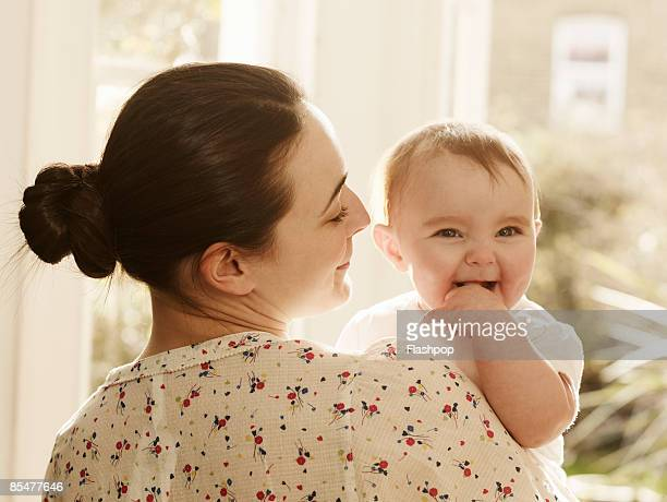 Portrait of woman holding baby