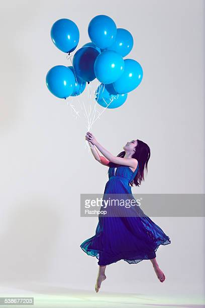 Portrait of woman holding balloons