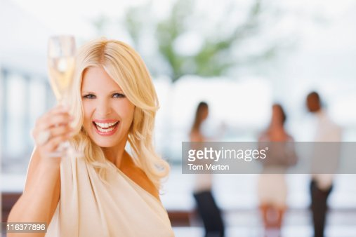 Portrait of woman holding champagne flute