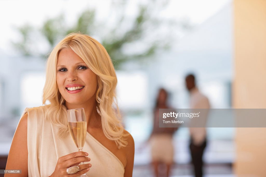 Portrait of woman holding champagne flute : Stock Photo