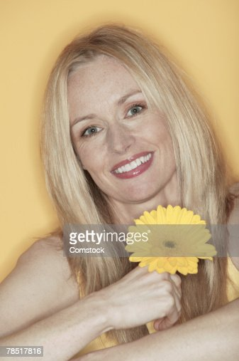 Portrait of woman holding flower : Stock Photo