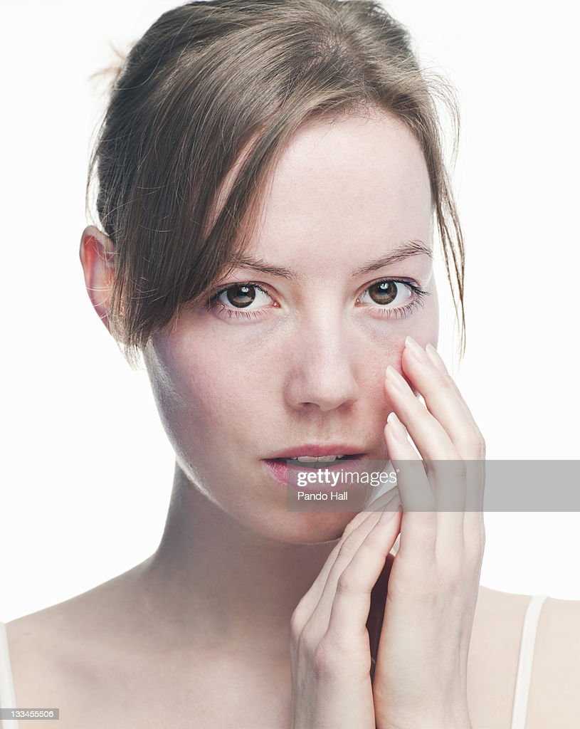 portrait of woman holding hands close to the face : Stock Photo