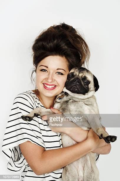 Portrait of woman hugging her pet