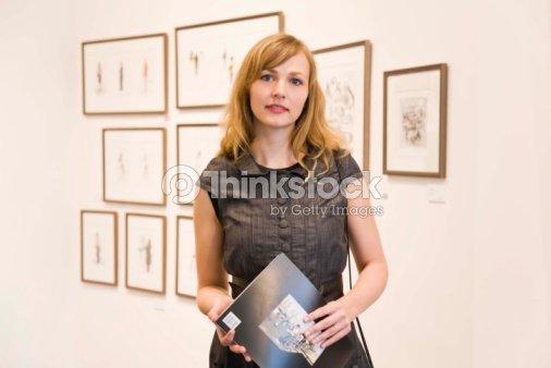 Portrait of woman in art gallery : Stock Photo