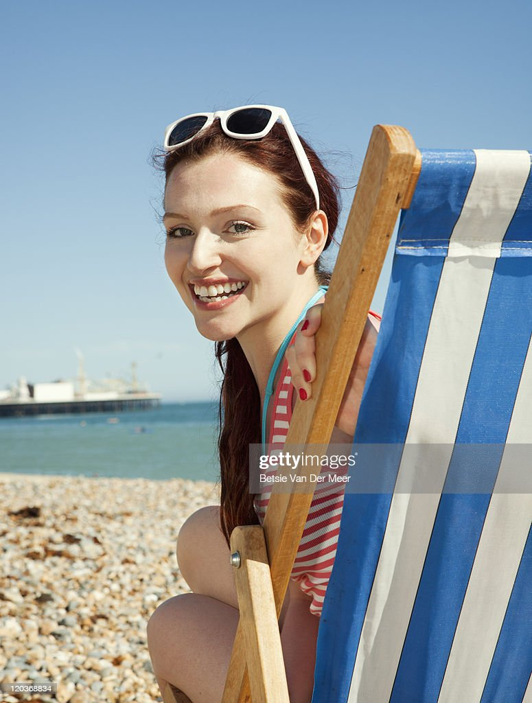 Portrait of woman in deckchair on beach. : Stock Photo