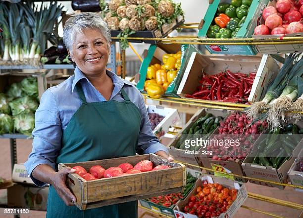 Portrait of woman in fruit and vegetable stall