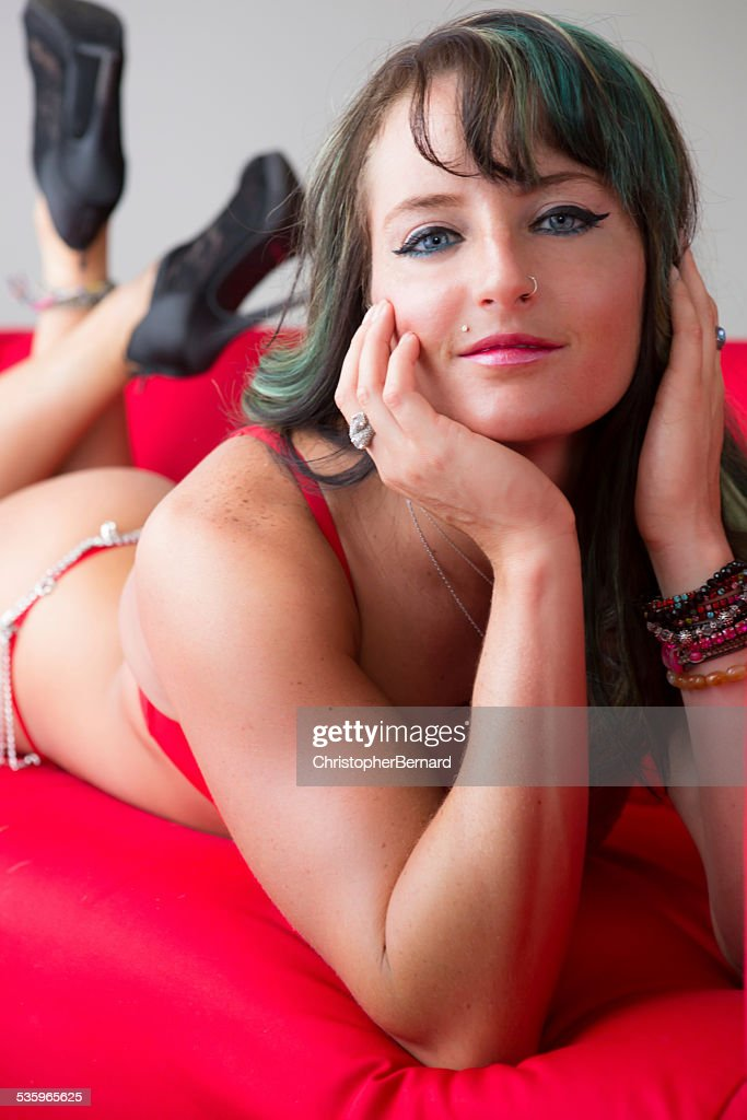 Portrait of woman in lingerie lying on couch. : Stock Photo