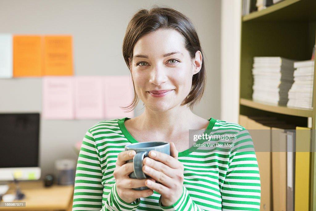 Portrait of woman in office.