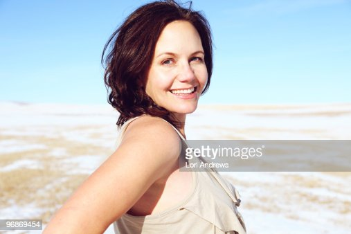 Portrait of woman in snowy field : Stock Photo