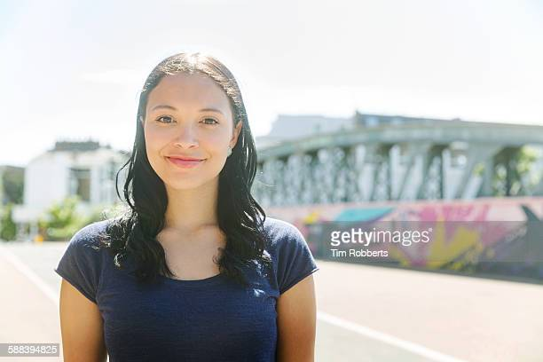 Portrait of woman in urban area.