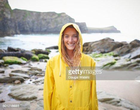 Portrait of woman in yellow raincoat