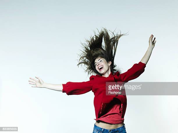 Portrait of woman jumping for joy