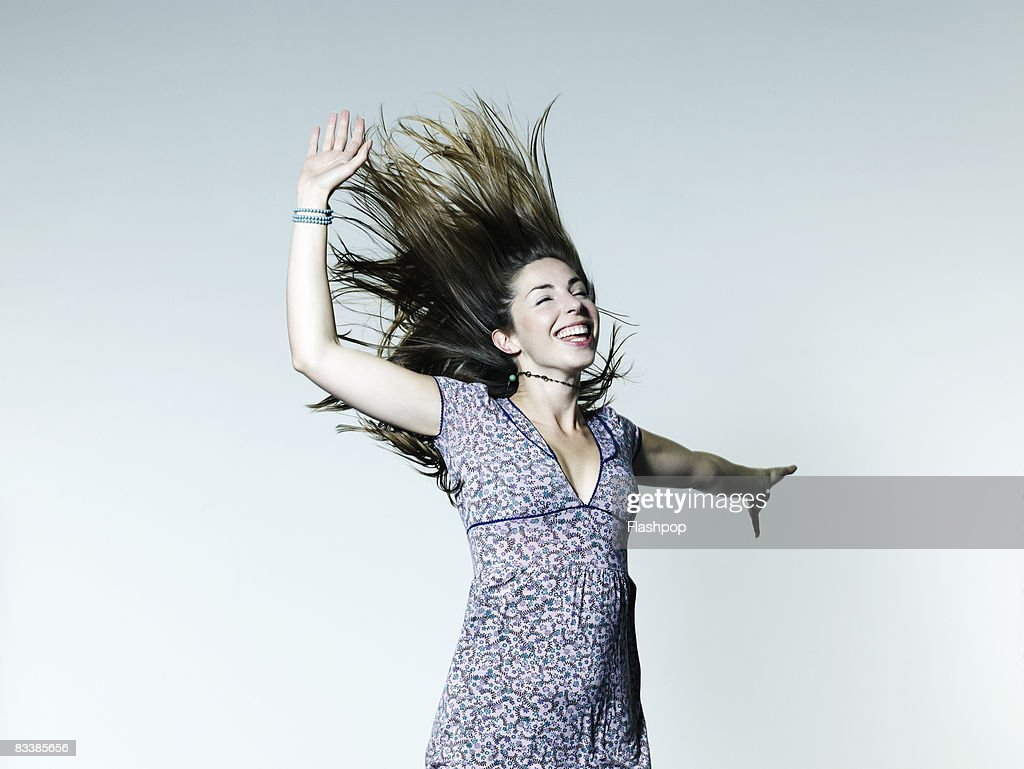 Portrait of woman jumping : Stock Photo