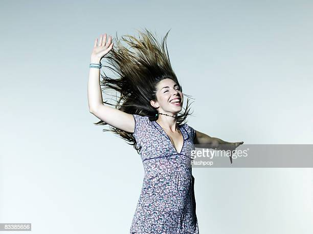 Portrait of woman jumping