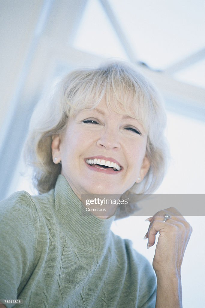 Portrait of woman laughing : Stock Photo