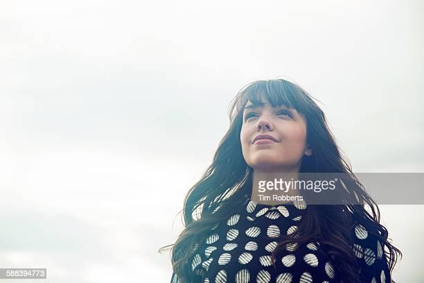 Portrait of woman looking ahead.