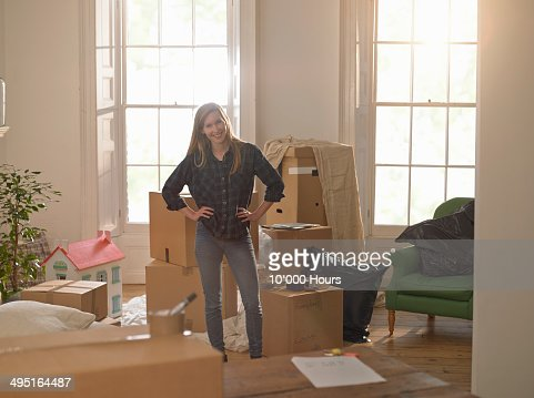 Portrait of woman moving into a new home