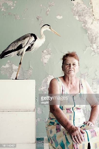 portrait of   woman next to   stuffed bird