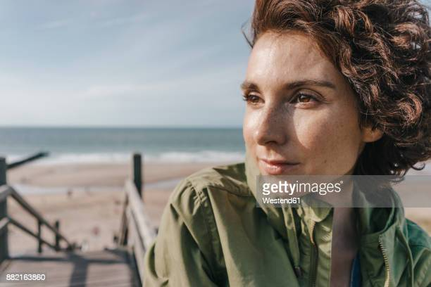 Portrait of woman on boardwalk at the beach
