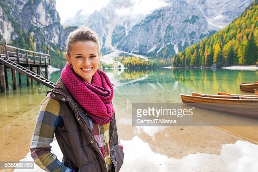 Portrait of woman on lake braies in south tyrol, italy : Stock Photo