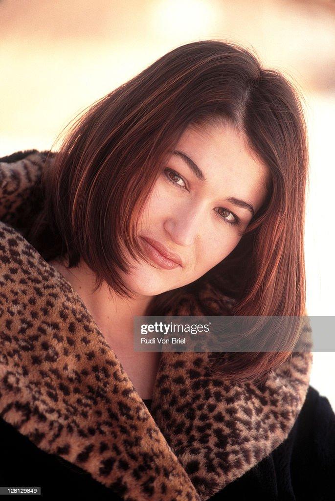 Portrait of woman outdoor in coat : Stock Photo