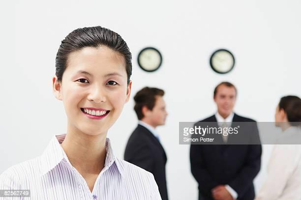 Portrait of woman, people behind