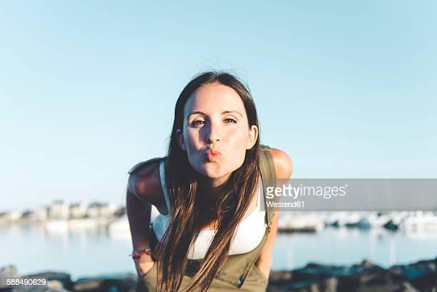 Portrait of woman pouting mouth