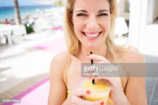 Portrait of woman relaxing at cafe nearby beach : Photo