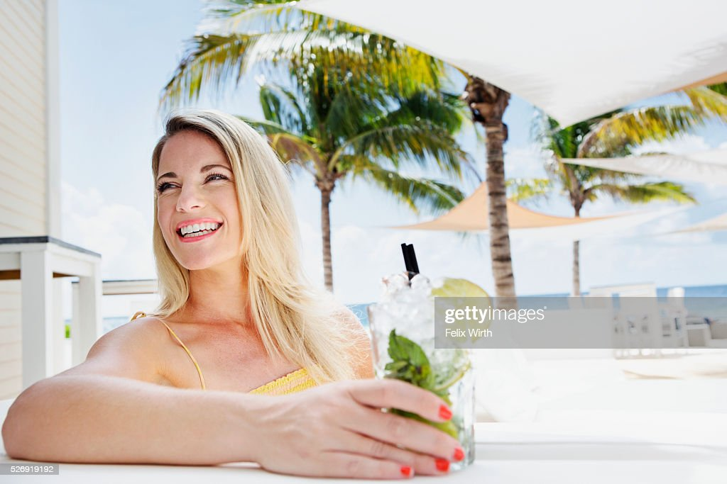 Portrait of woman relaxing at cafe nearby beach : Stock Photo