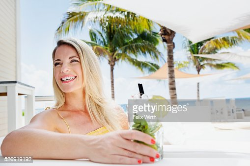 Portrait of woman relaxing at cafe nearby beach : Stock-Foto