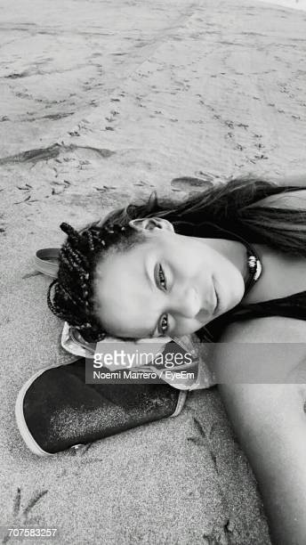 Portrait Of Woman Relaxing At Sandy Beach
