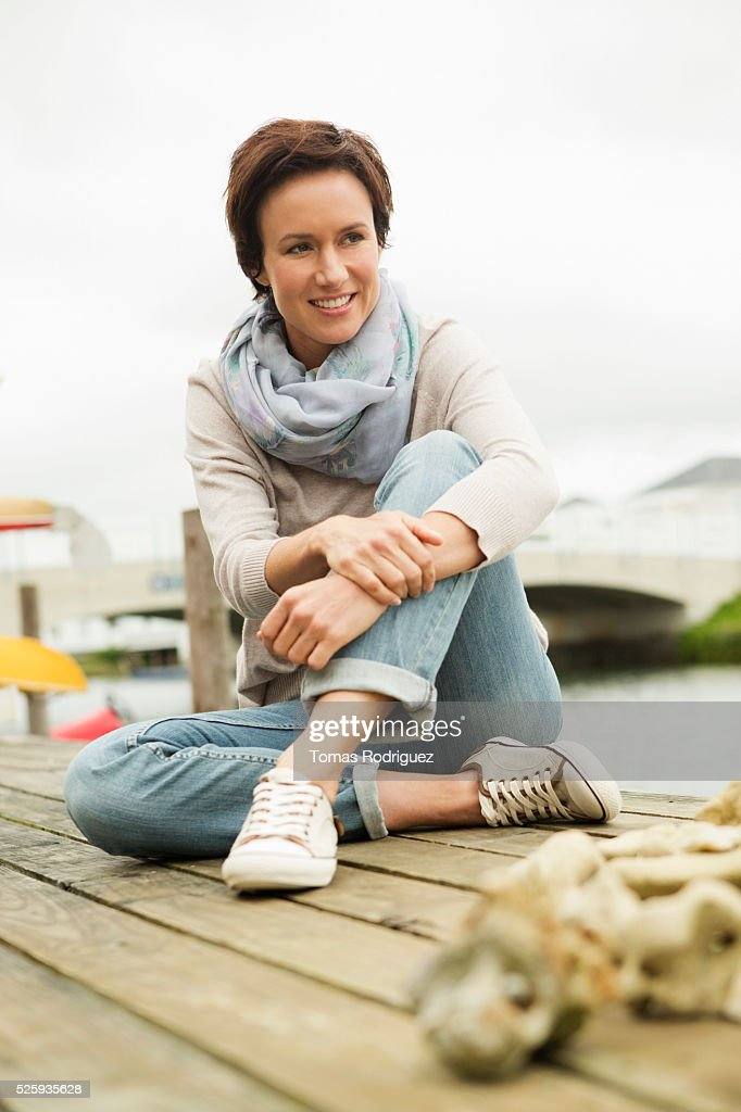 Portrait of woman relaxing on deck : Foto stock